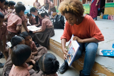 A Garfield High School students reads to kids